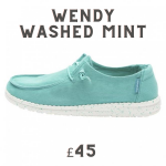 pair of ladies slip-on shoes in green
