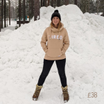 lady wearing a cream hoodie in snow
